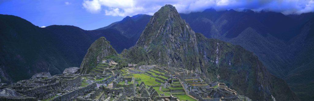 Colorful panoramic of Machu Picchu ruins from above in beautiful Peru